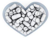 Muchas tabletas y vitamina en corazón de la forma Fotografía de archivo libre de regalías