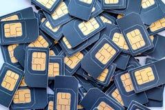 Muchas tarjetas de SIM están en una pila Imagen de archivo