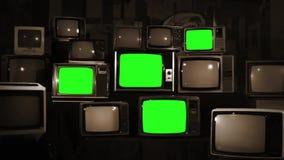 Muchas TV con las pantallas verdes Tono de la sepia