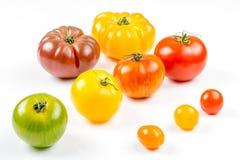 Muchas variedades de tomates coloridos Fotos de archivo libres de regalías