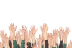 Muchedumbre de gente y de manos para arriba Imagen de archivo libre de regalías