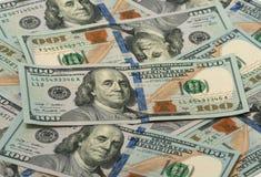 Mucho cientos billetes de dólar Foto de archivo