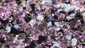 Mucho la joya púrpura oscura empiedra el fondo, lazo listo metrajes