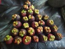 Mucho mangostán en la cesta Imagen de archivo