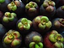 Mucho mangostán en la cesta Fotografía de archivo