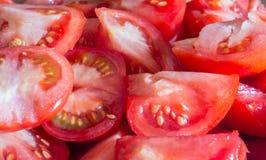 Mucho tomate rojo que procesa cocinar Foto de archivo libre de regalías