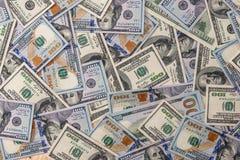 muchos billetes de banco de 100 dólares Fotografía de archivo libre de regalías