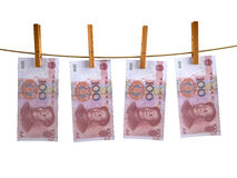 Muchos billetes de banco del yuan de China hunging Foto de archivo