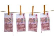 Muchos billetes de banco del yuan de China hunging Imagen de archivo