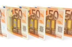 Muchos 50 billetes de banco euro en línea Foto de archivo libre de regalías