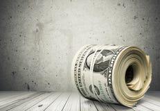 Muchos cientos billetes de dólar ataron la goma Fotografía de archivo libre de regalías