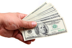 Muchos dólares en el fondo blanco Foto de archivo libre de regalías