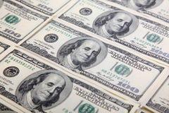 Muchos dólares en el fondo blanco Imagen de archivo libre de regalías