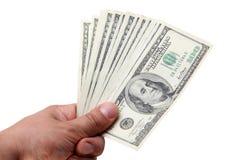 Muchos dólares en el fondo blanco Imágenes de archivo libres de regalías