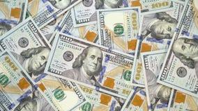 Muchos dólares giran Fondo de la vuelta de cientos usd vuelta 4k de 100 dolares almacen de video