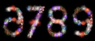 Muchos grupos de fuegos artificiales de estallido formaron como números Fotos de archivo libres de regalías