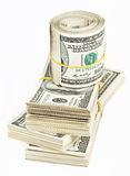 Muchos lían y rodillo de los E.E.U.U. 100 dólares de billetes de banco Imagenes de archivo