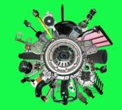 Muchos nuevos recambios para un coche aislado en fondo verde Imagen de archivo libre de regalías