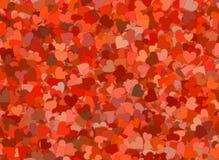 Muchos pequeños fondos rojos de los corazones Foto de archivo libre de regalías
