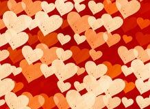 Muchos pequeños fondos rojos de los corazones del punto Fotos de archivo libres de regalías
