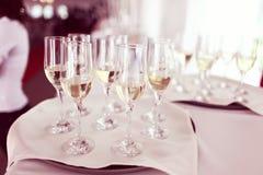 Muchos vidrios del champán Fotos de archivo