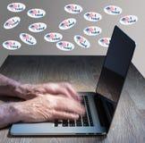 Muchos voté etiquetas engomadas en la pared del pirata informático del voto Foto de archivo libre de regalías