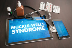 Muckle-Wells syndrome (cutaneous disease) diagnosis medical conc. Ept on tablet screen with stethoscope Stock Photo