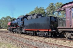 The J 549 tourist steam train departing Muckleford railway station. MUCKLEFORD, AUSTRALIA - March 11, 2018: The J 549 tourist steam train departing Muckleford royalty free stock photos