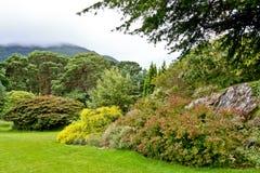 Gardens Muckross Killarney National Park, Ireland. Muckross House, County Kerry, Ireland - is a Tudor style mansion built in 1843 located on the small Muckross Royalty Free Stock Photo