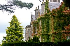 Muckross House, Killarney, Ireland. Muckross House, County Kerry, Ireland - is a Tudor style mansion built in 1843 located on the small Muckross Peninsula Stock Image