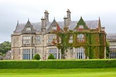 Facade of Muckross House, Killarney, Ireland. Muckross House, County Kerry, Ireland - is a Tudor style mansion built in 1843 located on the small Muckross Stock Photos