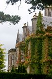 Side view of Muckross House, Killarney, Ireland. Muckross House, County Kerry, Ireland - a Tudor style mansion built in 1843 located on the small Muckross Royalty Free Stock Images