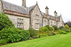 Side view of Muckross House, Killarney, Ireland. Muckross House, County Kerry, Ireland - a Tudor style mansion built in 1843 located on the small Muckross Stock Photography
