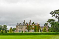 Muckross House, Killarney, Ireland. Muckross House, County Kerry, Ireland - is a Tudor style mansion built in 1843 located on the small Muckross Peninsula Royalty Free Stock Photography