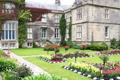 Rose garden at the Muckross House, Killarney, Ireland. Muckross House, County Kerry, Ireland - is a Tudor style mansion built in 1843 located on the small Royalty Free Stock Photography