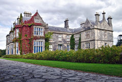 Muckross House, Ireland. Muckross House, County Kerry, Ireland - is a Tudor style mansion built in 1843 located on the small Muckross Peninsula between two of Royalty Free Stock Photos