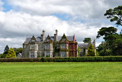Muckross House, Ireland. Muckross House, County Kerry, Ireland - is a Tudor style mansion built in 1843 located on the small Muckross Peninsula between two of Stock Photography