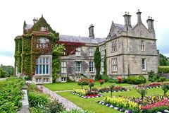 Muckross House and rose garden, Killarney, Ireland. Muckross House, County Kerry, Ireland - is a Tudor style mansion built in 1843 located on the small Muckross Royalty Free Stock Images