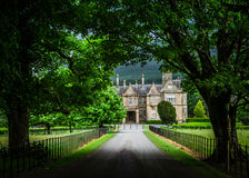 Muckross House. The view Muckross House in Killarney County Kerry through the shadow of the avenue of trees Stock Photos
