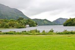 Muckross Lake, near Killarney, Ireland. Muckross Lake, Killarney, Ireland with mountains in background Stock Image