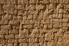 Mud Adobe Wall Texture. Wall for background or texture of mud and straw bricks (adobe) baked in the sun Stock Photography