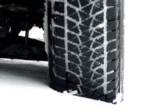 Mud all-terrain tire tread packed with snow stock photo. Off road truck wheels on the snow close up stock photo Stock Image