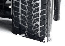 Mud all-terrain tire tread packed with snow stock photo Royalty Free Stock Photo