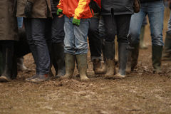 Mud and boots Stock Photos
