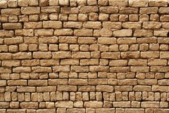 Mud brick wall. Wall built from mud bricks, used for construction in Egypt and other African countries Stock Photos
