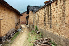 Mud brick wall found in China 2. Mud brick wall together with some firewood in China Stock Photos