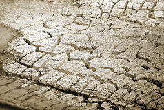 Mud Caldron and cracked earth Stock Images