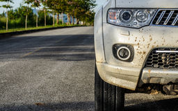 Mud on the car. After drive though the off-road way during sunset Royalty Free Stock Photography