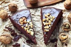 Mud chocolate cake. Close up of two pieces of home made chocolate hazelnut mud cake Royalty Free Stock Photo