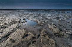 Mud on coast during low tide in Nirth sea Stock Images